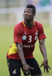 Ghana's soccer player Asamoah Gyan dances during their training in Ngouoni, 45km outside Franceville, Gabon, Friday Jan. 27, 2012. Ghana will play their African Cup of Nations Group D soccer match against Mali on Saturday Jan. 28, 2012. (AP Photo/Themba Hadebe)