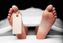 Photo of Elders exhume corpse following land dispute